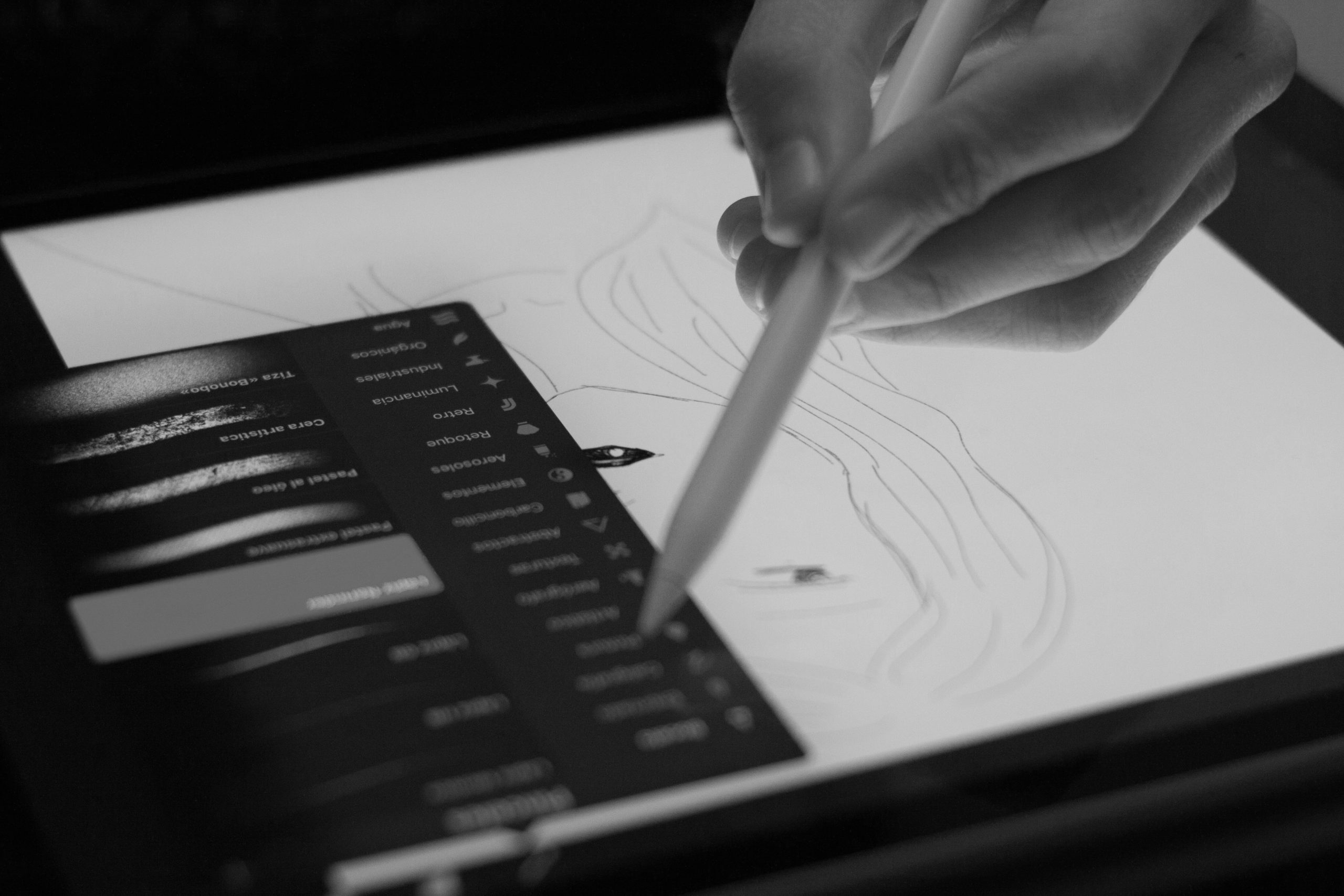 Hand using an iPad for illustration